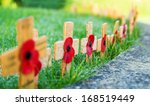 Remembrance Poppies On Wooden...