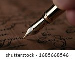 Fountain Pen In The Hand With...