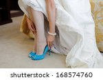 bride sitting on bed and... | Shutterstock . vector #168574760