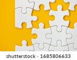 Puzzle pieces on orange...