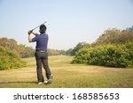 golfer hits an fairway shot... | Shutterstock . vector #168585653