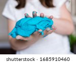 Small photo of Child hands playing with colorful clay. Homemade plastiline. Plasticine. play dough. Girl molding modeling clay. Homemade clay.