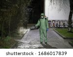 Small photo of Sanitization, cleaning and disinfection of the streets and alleys in the city center due to the emergence of the Covid-19 virus. Specialized team with protective suits and masks at work in the city.