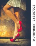 woman legs in red high heel... | Shutterstock . vector #168607028
