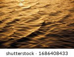 Golden Color Water Waves On...