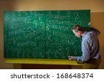 man at the blackboard writes... | Shutterstock . vector #168648374