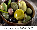 different olive fruits on... | Shutterstock . vector #168662420
