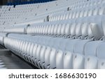 Empty white seats at the american football stadium during isolation period