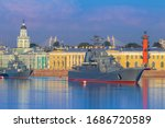 Small photo of Saint Petersburg. Russia. Rivers Of St. Petersburg. Warships on the Neva. Vasilievsky island. Ships on the background of the Kunstkamera. Military fleet. Navy. Warships near the Rostral columns.