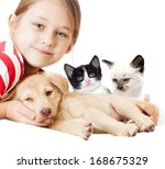 Stock photo girl with kitten and puppy 168675329