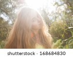 backlit image of the pretty... | Shutterstock . vector #168684830