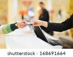at hotel reception | Shutterstock . vector #168691664