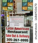 Small photo of Miami, Florida/USA - March 29, 2020: Takeout orders with COVID-19 cautionary instructions