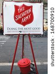 Small photo of NEW YORK - DECEMBER 19 Salvation Army red kettle for collections on December 19, 2013 in midtown Manhattan This Christian organization is known for its charity work, operating in 126 countries