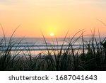 Intense Sunrise Over A Beach...