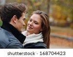 lovely couple enjoying fall in... | Shutterstock . vector #168704423