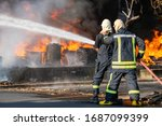 Fireman Or Firefighter Spraying ...