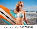beautiful young woman surfer... | Shutterstock . vector #168710684