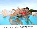 happy family enjoying bath time ... | Shutterstock . vector #168722696