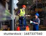 Workers In Logistics Warehouse...