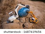 Two Small Toy Excavators On...