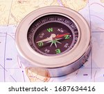 Compass In Hand. Compos Lying...