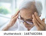 Small photo of Sick senior woman with headache,pain in the head,brain system problems,chronic illness,elderly has dizziness,symptoms of benign paroxysmal positional vertigo,meniere's disease or fatigue,lack of sleep