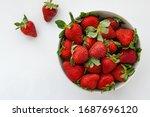 Ripe Red Strawberries On White...