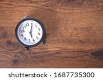 Clock On The Wooden Table...