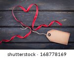 a heart of red ribbon with... | Shutterstock . vector #168778169