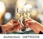 Celebration. People holding glasses of champagne making a toast. Champage with blurred background