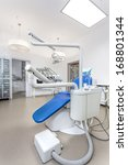 Dentist equipment with seat and tools, vertical - stock photo