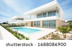 Small photo of Portugal, Lagos, 05 April 2018 - illustrative editorial. White villa, cottage, luxury house for recreation with swimming pool, terrace with a view, balcony, modern design.