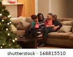 family celebrating christmas at ... | Shutterstock . vector #168815510