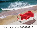 Woman With A Red Tissue On The...