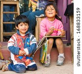 Small photo of PERU - NOVEMBER 3, 2010: Three undentified children play in their father shop in Peru, Nov 3, 2010. Over 50 per cent of people in Peru live below the the poverty line.