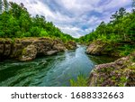 Forest river wild water view. Mountain forest river rocks. Forest river rocks landscape