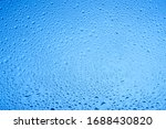 Blue Water Drops On Glass....