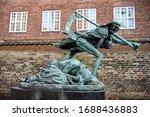An Allegorical Sculpture Of...