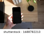 Hand Holding Smartphone....