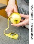 female peeling green apples in... | Shutterstock . vector #168882923
