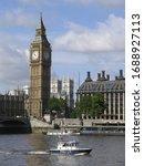 Police boat patrolling in the Thames river, London