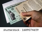 Los Angeles, CA - March 31, 2020:  United States Department of Treasury issued Internal Revenue Service refund checks for income tax.  Also a illustration for stimulus checks issued.  - stock photo