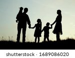 Silhouette Of A Happy Family...