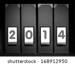 Four black binders with New Year 2014 digits placed on bookshelf - stock photo