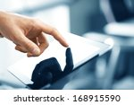 hand holding and pushing tablet | Shutterstock . vector #168915590