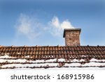 smoke raising from a chimney in ... | Shutterstock . vector #168915986