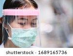 Female doctor nurse wearing...