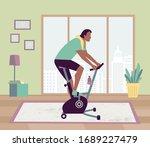 Healthy Man Riding Stationary...