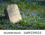 Old Cemetery Tombstone In Blue...